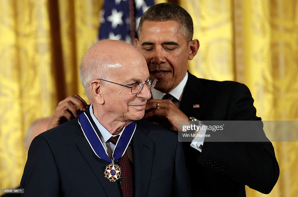 U.S. President Barack Obama awards the Presidential Medal of Freedom to Daniel Kahneman in the East Room at the White House on November 20, 2013 in Washington, DC. The Presidential Medal of Freedom is the nation's highest civilian honor, presented to individuals who have made meritorious contributions to the security or national interests of the United States, to world peace, or to cultural or other significant public or private endeavors.