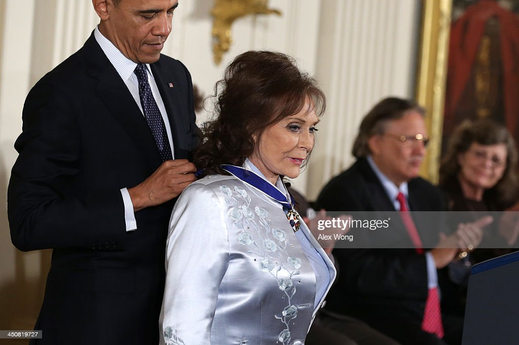 U.S. President Barack Obama (L) awards the Presidential Medal of Freedom to country music legend Loretta Lynn (R) in the East Room at the White House on November 20, 2013 in Washington, DC. The Presidential Medal of Freedom is the nation's highest civilian honor, presented to individuals who have made meritorious contributions to the security or national interests of the United States, to world peace, or to cultural or other significant public or private endeavors.