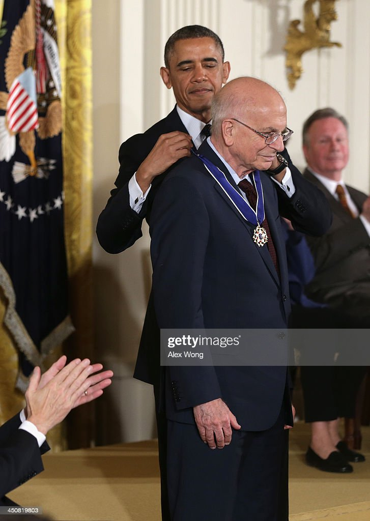 U.S. President Barack Obama (L) awards the Presidential Medal of Freedom to scholar in psychology Daniel Kahneman (R) in the East Room at the White House on November 20, 2013 in Washington, DC. The Presidential Medal of Freedom is the nation's highest civilian honor, presented to individuals who have made meritorious contributions to the security or national interests of the United States, to world peace, or to cultural or other significant public or private endeavors.