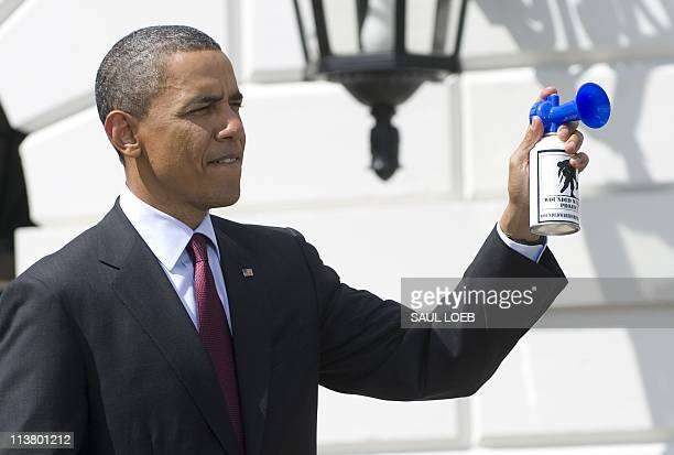 US President Barack Obama blows an air gun to mark the start of a ride by bicyclists from the Wounded Warrior Project's Soldier Ride around the...