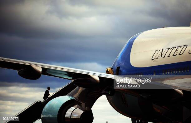US President Barack Obama boards Air Force One as he leaves Boston after speaking at a fundraising rally for Massachusetts Governor Deval Patrick on...