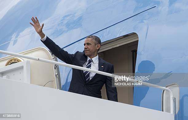 US President Barack Obama boards Air Force One at Andrews Air Force Base in Maryland on May 18 2015 as he departs for Camden New Jersey President...