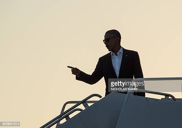 US President Barack Obama boards Air Force One at RaleighDurham International Airport in Morrisville North Carolina on November 2 2016 as he departs...