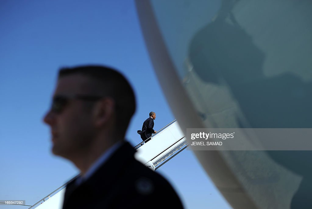 US President Barack Obama boards Air Force One at the Andrews Air Force Base in Maryland on April 3, 2013 en route to Denver, Colorado, where he will continue asking the American people to join him in calling on Congress to pass common-sense measures to reduce gun violence. The president has demanded votes on measures including a requirement for background checks on all gun purchases, limits on high capacity ammunition magazines, a reinstated assault weapons ban, new gun trafficking laws, and new school safety plans. But the assault weapons ban push appears certain to fail to get sufficient support in the Senate, following a huge campaign by the gun lobby and opposition from Republicans and Democrats from conservative and rural areas. AFP PHOTO/Jewel Samad