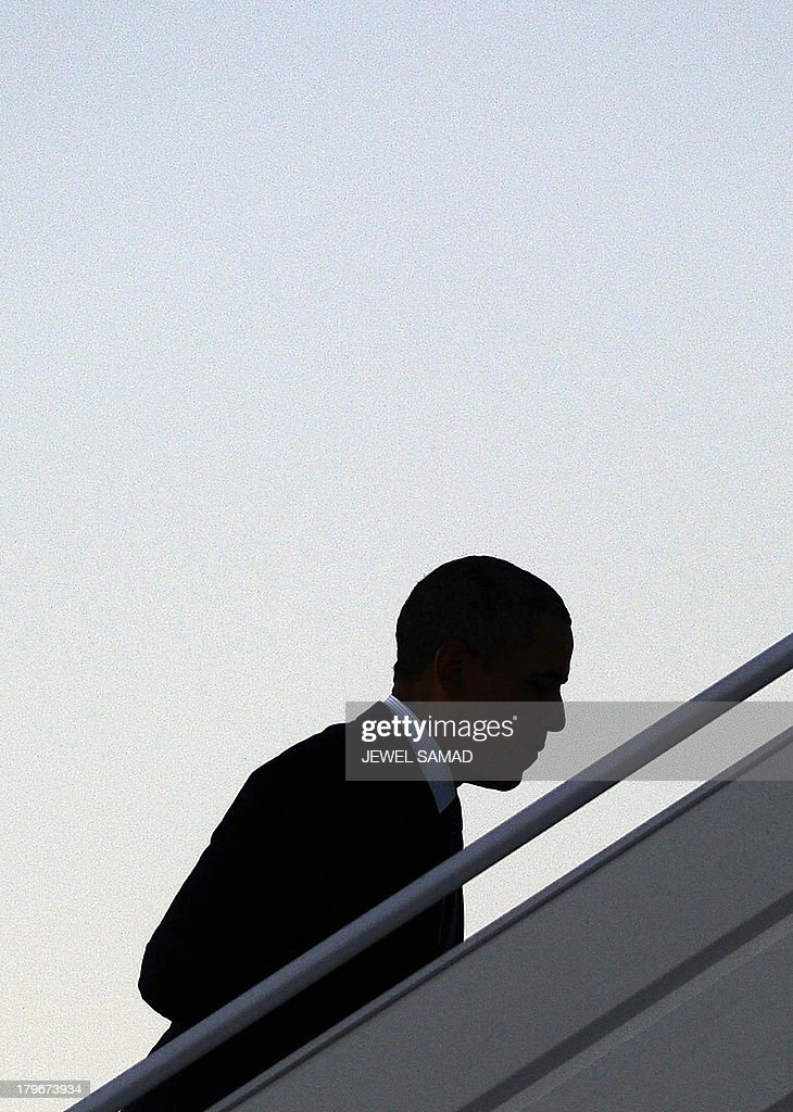 US President Barack Obama boards Air Force One at the Pulkovo International Airport in Saint Petersburg on September 6, 2013, as he leaves for Washington, DC, after attending the G20 summit. World leaders at the G20 summit today failed to bridge their bitter divisions over US plans for military action against the Syrian regime, with Washington signalling that it has given up on securing Russia's support at the UN on the crisis.