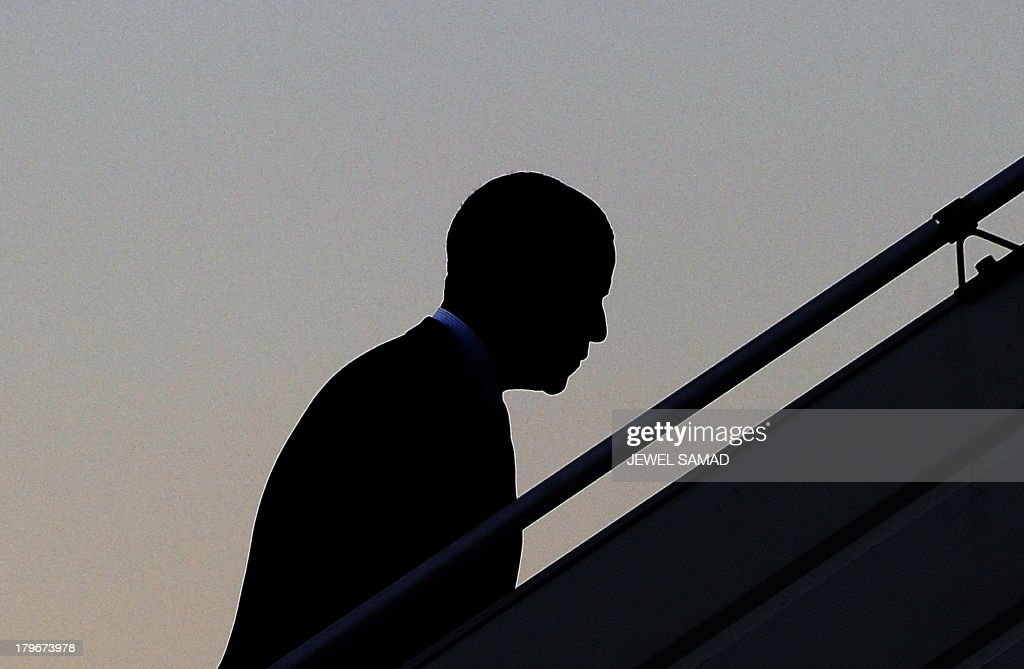US President Barack Obama boards Air Force One at the Pulkovo International Airport in Saint Petersburg on September 6, 2013, as he leaves for Washington, DC, after attending the G20 summit. World leaders at the G20 summit today failed to bridge their bitter divisions over US plans for military action against the Syrian regime, with Washington signalling that it has given up on securing Russia's support at the UN on the crisis. AFP PHOTO / JEWEL SAMAD