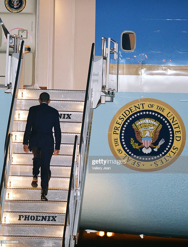 U.S. President Barack Obama boards Air Force One back to White House from Miami after attending a private DNC fundraising event. POTUS depart at Miami International Airport on June 12, 2013 in Miami, Florida.