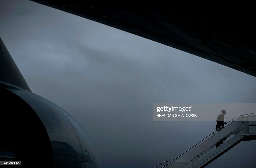 President Barack Obama boards his plane 'Air Force One' prior to his departure on November 18, 2016 at the Tegel airport in Berlin, where the US President met the German Chancellor and other European leaders. US President Barack Obama's choice of Berlin as the stop for his European farewell tour has been interpreted by some observers as the passing of baton of the defence of liberal democracy to German Chancellor Angela Merkel. / AFP / Brendan Smialowski