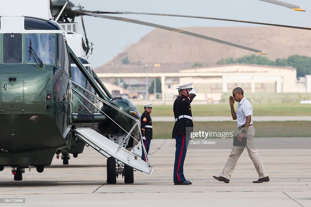 President Barack Obama boards Marine One before departing for Camp David on July 30 2016 at Joint Base Andrews in Maryland The president will remain...