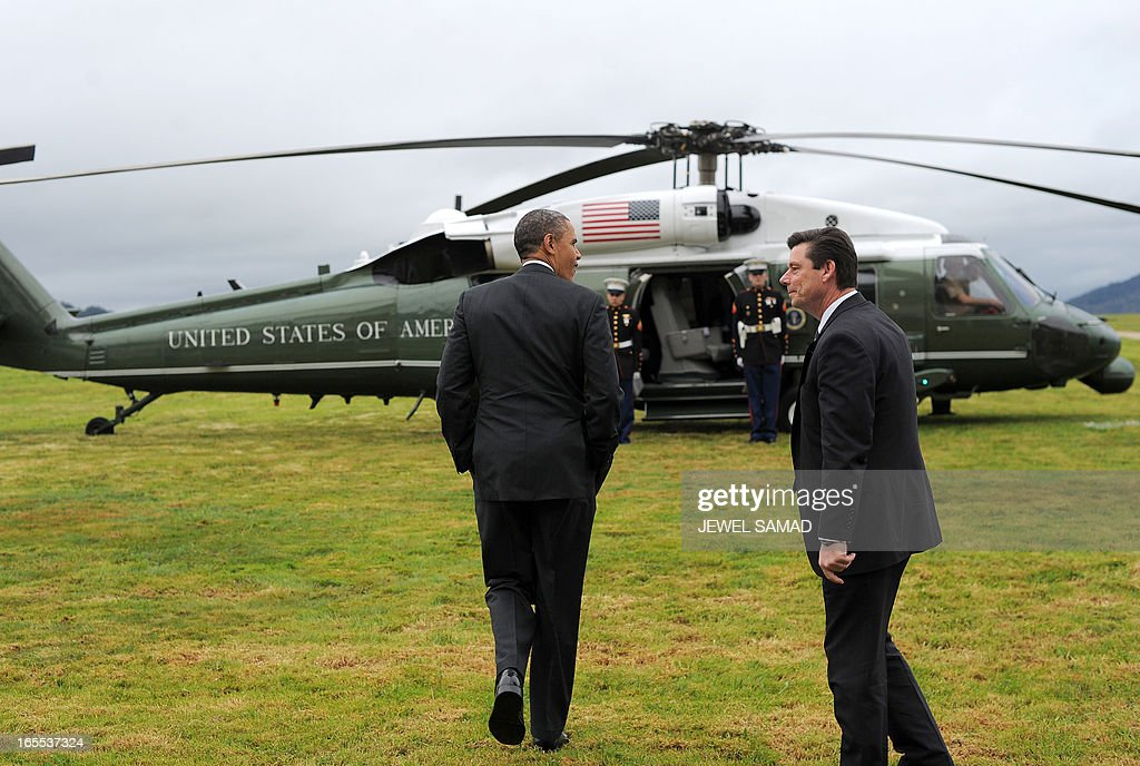 US President Barack Obama boards Marine One helicopter from a field overlooking the iconic golden gate bridge in San Francisco, California, on April 4, 2013. Obama is in California to attend two DCCC fund rising events. AFP PHOTO/Jewel Samad