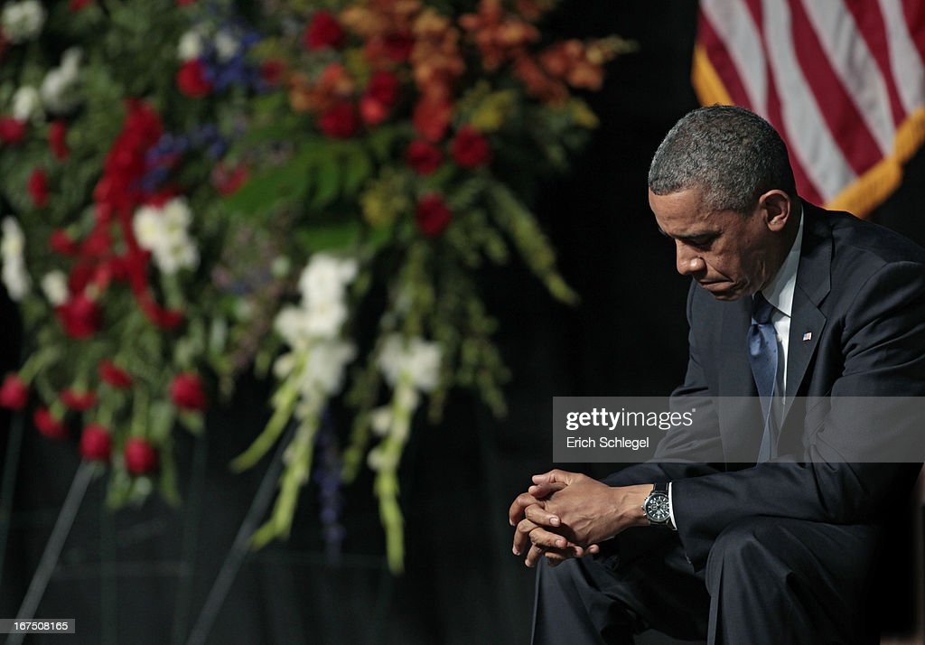 U.S. President <a gi-track='captionPersonalityLinkClicked' href=/galleries/search?phrase=Barack+Obama&family=editorial&specificpeople=203260 ng-click='$event.stopPropagation()'>Barack Obama</a> bows his head at the West memorial service held at Baylor University April 25, 2013 in Waco, Texas. The memorial service honored the volunteer firefighters that lost their lives at the fertilizer plant explosion in West, Texas last week.