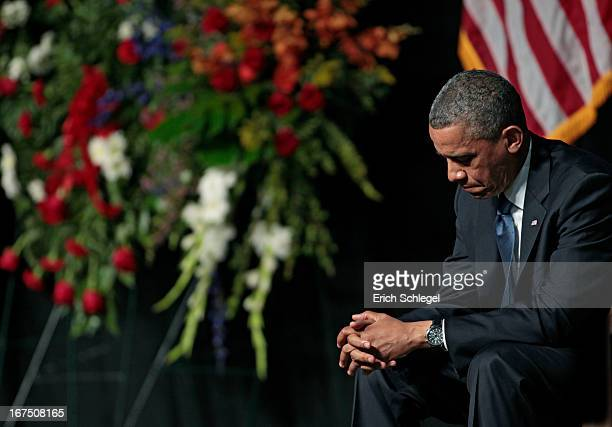 S President Barack Obama bows his head at the West memorial service held at Baylor University April 25 2013 in Waco Texas The memorial service...