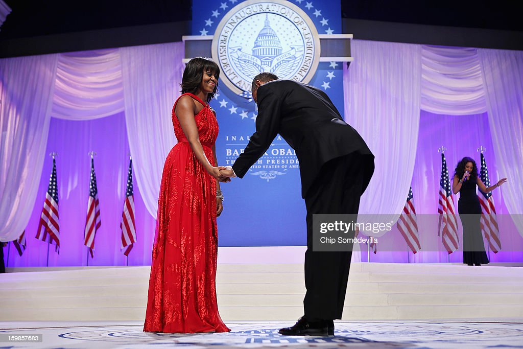 U.S. President Barack Obama bows to first lady Michelle Obama before they dance during the Comander-in-Chief's Inaugural Ball at the Walter Washington Convention Center January 21, 2013 in Washington, DC. Obama was sworn-in for his second term of office earlier in the day.