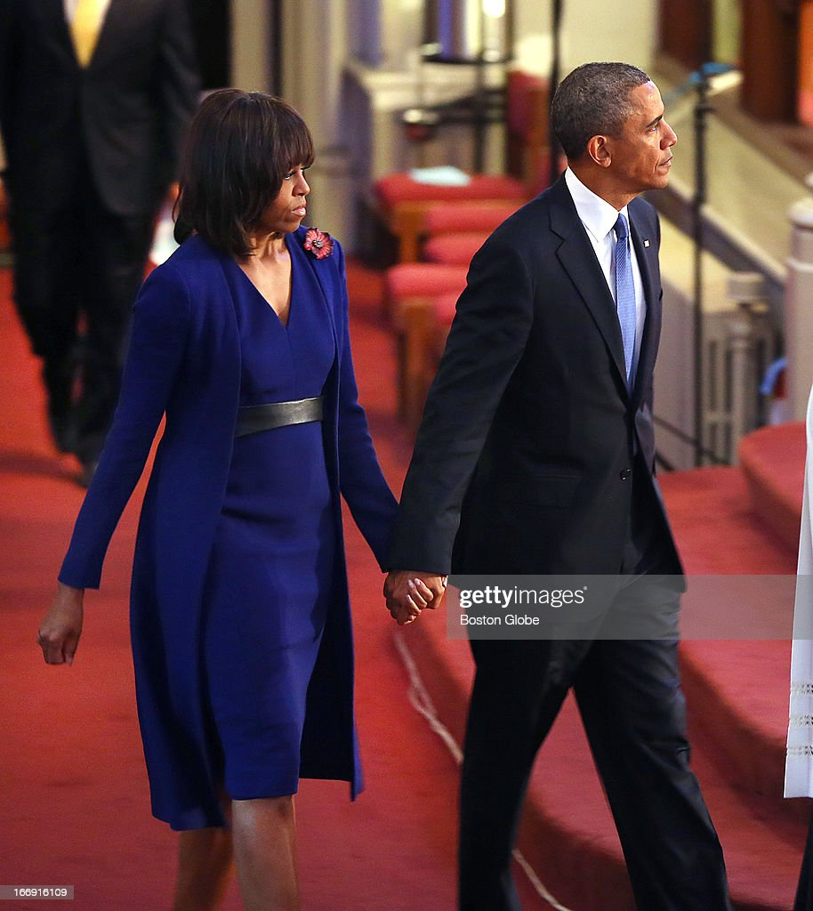 President Barack Obama came to Boston to the Cathedral of the Holy Cross for an interfaith healing service for the victims of the Boston Marathon bombing. He arrives holding hands with his wife, Michelle Obama.