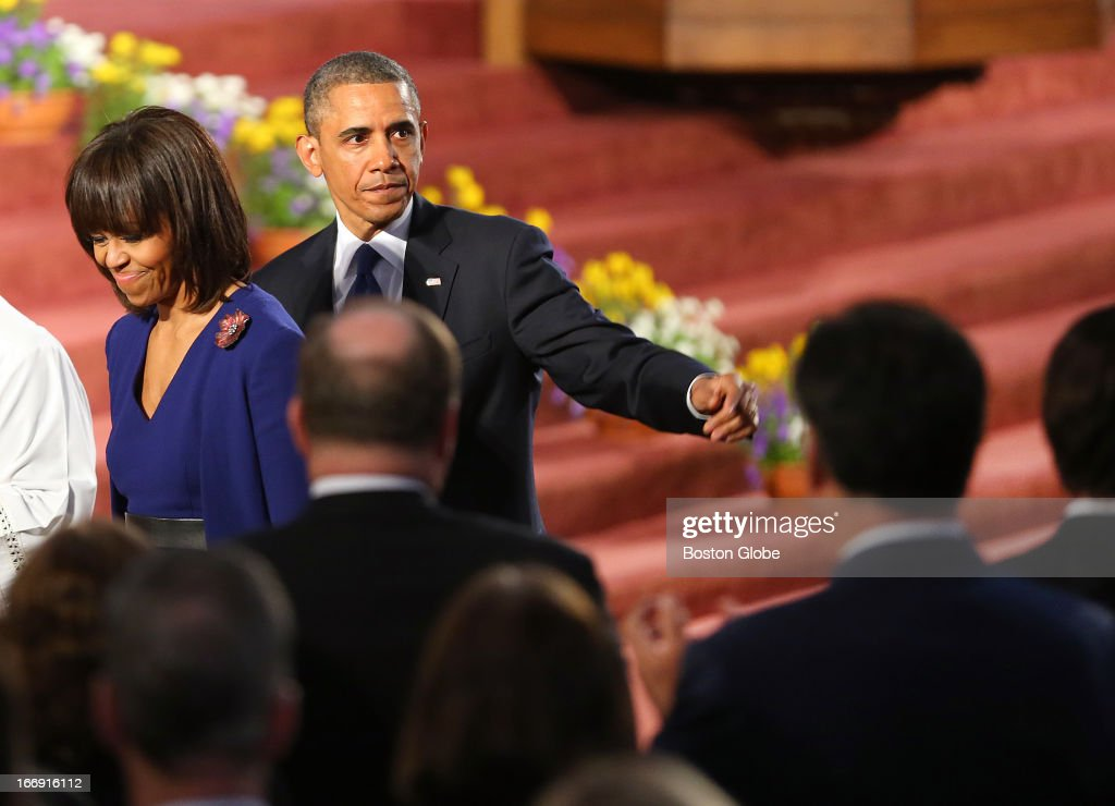 President Barack Obama came to Boston to the Cathedral of the Holy Cross for an interfaith healing service for the victims of the Boston Marathon bombing. He walks past Mitt Romney, right fore, with his wife, Michelle Obama.