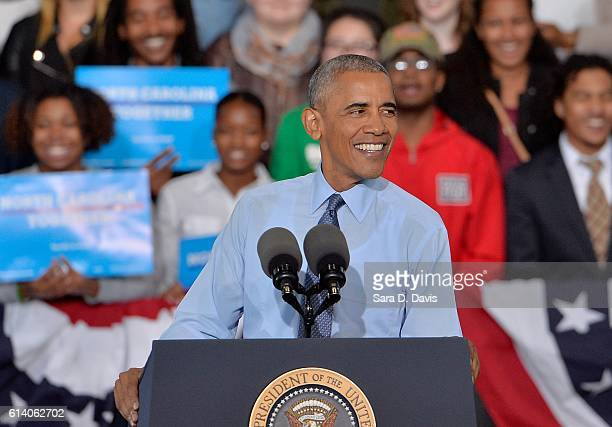 S President Barack Obama campaigns on behalf of Democratic presidential nominee Hillary Clinton on October 11 2016 in Greensboro North Carolina...