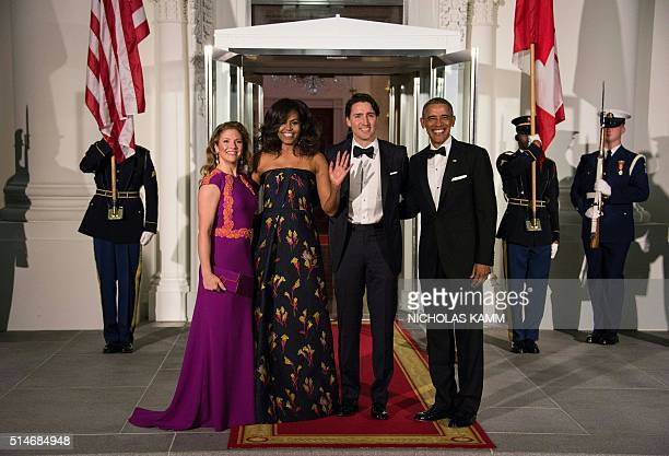 US President Barack Obama Canadian Prime Minister Justin Trudeau and their wives Michelle Obama and Sophie Gregoire Trudeau pose upon the Trudeau's...