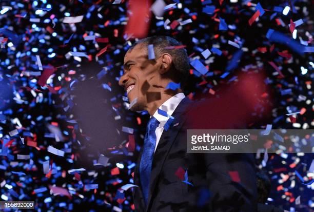 US President Barack Obama celebrates after delivering his acceptance speech ion Chicago on November 7 2012 Obama swept to reelection forging history...