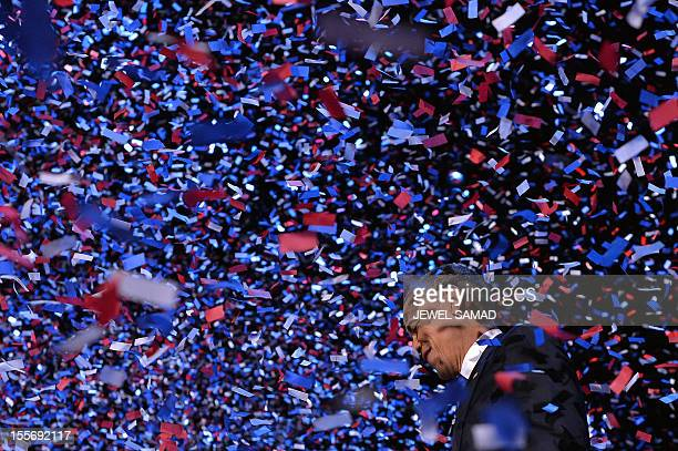 US President Barack Obama celebrates on stage on election night in Chicago on November 6 2012 Obama swept to reelection forging history again by...