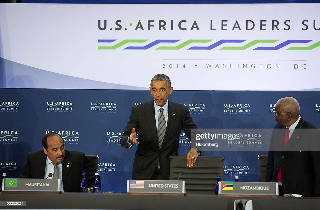U.S. President <a gi-track='captionPersonalityLinkClicked' href=/galleries/search?phrase=Barack+Obama&family=editorial&specificpeople=203260 ng-click='$event.stopPropagation()'>Barack Obama</a>, center, arrives for a session entitled 'Investing in Africa's Future' with <a gi-track='captionPersonalityLinkClicked' href=/galleries/search?phrase=Mohamed+Ould+Abdel+Aziz&family=editorial&specificpeople=5482530 ng-click='$event.stopPropagation()'>Mohamed Ould Abdel Aziz</a>, president of Mauritania, left, and <a gi-track='captionPersonalityLinkClicked' href=/galleries/search?phrase=Armando+Guebuza&family=editorial&specificpeople=569903 ng-click='$event.stopPropagation()'>Armando Guebuza</a>, president of Mozambique, during the U.S.-Africa Leaders Summit at the State Department in Washington, D.C., U.S., on Wednesday, Aug. 6, 2014. Obama said Africa represents a great opportunity for American companies to expand their investments, as the U.S. competes with China to tap some of the worlds fastest growing economies. Photographer: Drew Angerer/Bloomberg via Getty Images