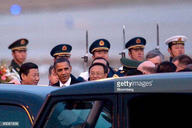 US President Barack Obama center is greeted by Xi Jinping China's vice president left and Yang Jiechi China's foreign minister upon his arrival in...