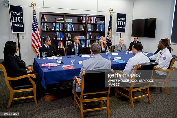 US President Barack Obama center left speaks while participating in a roundtable discussion on the impacts of climate change on public health with...