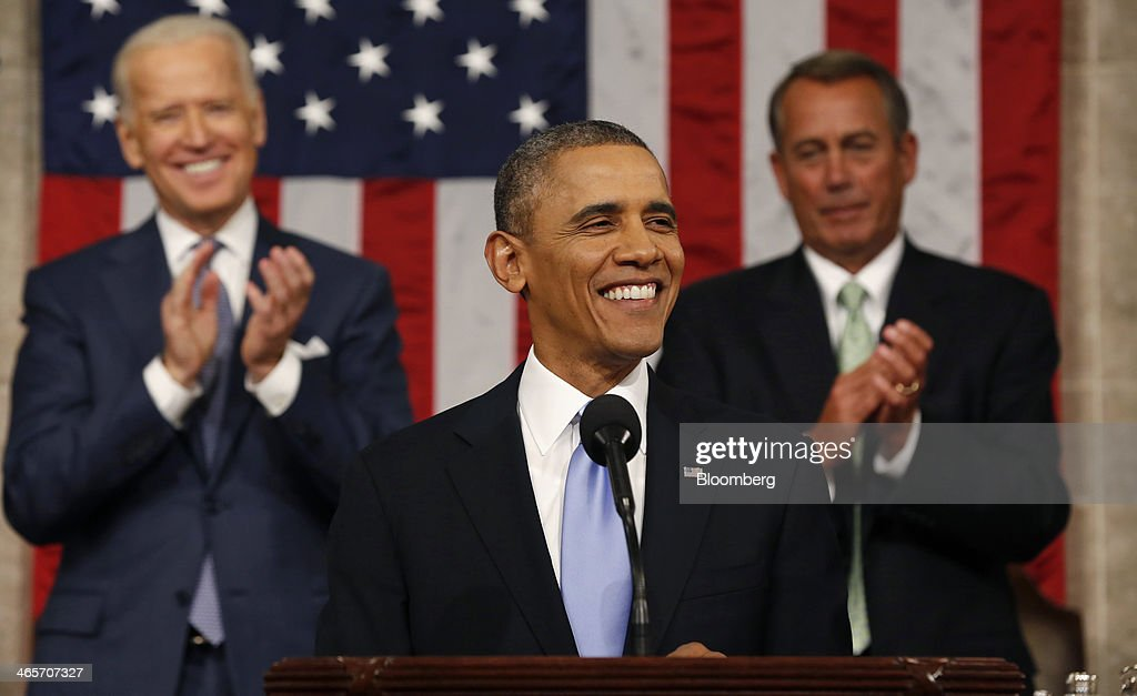 U.S. President Barack Obama, center, smiles after delivering the State of the Union address to a joint session of Congress as U.S. Vice President Joseph 'Joe' Biden, left, and House Speaker John Boehner, a Republican from Ohio, applaud at the Capitol in Washington, D.C., U.S., on Tuesday, Jan. 28, 2014. Obama offered modest steps to chip away at the country's economic and social challenges in a State of the Union address that reflects the limits of his power to sway Congress. Photographer: Larry Downing/Pool via Bloomberg