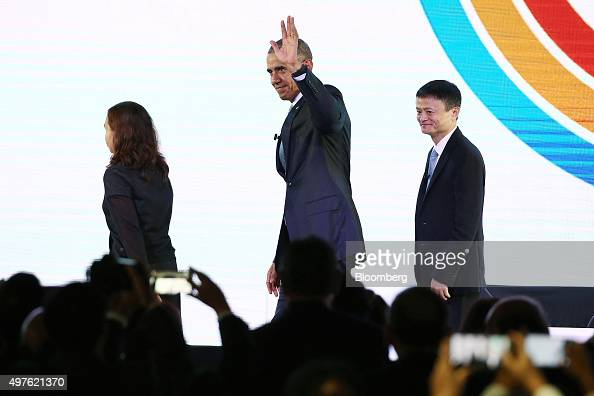 US President Barack Obama center waves as he leaves the stage with billionaire Jack Ma chairman of Alibaba Group Holding Ltd right and engineer Aisa...