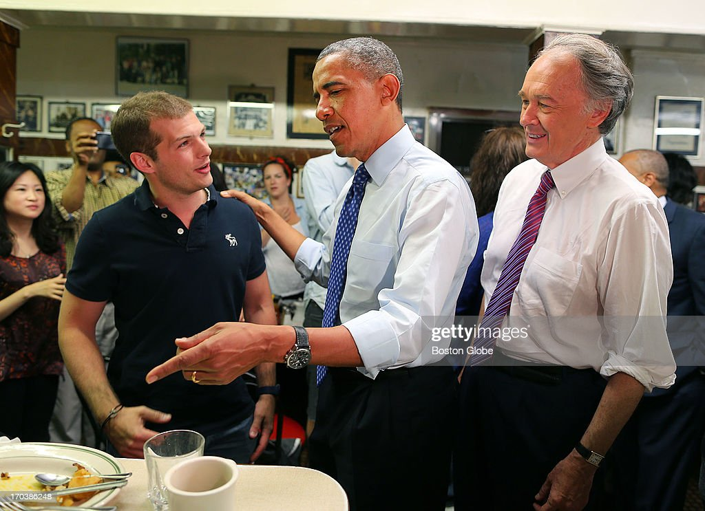President Barack Obama chats with Benjamin Gay from Paris, as he points to his omelette on the counter, as Congressman Ed Markey looks on, at Charlie's Sandwich Shoppe in the South End. President Barack Obama visited Boston on behalf of Congressman Ed Markey, who is running for the open U.S. Senate seat vacated by Secretary of State John Kerry. Previously, the President attended a rally at the Reggie Lewis Track and Athletic Center.