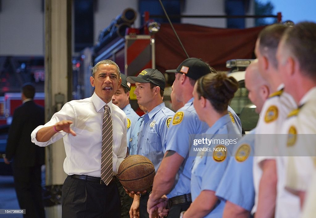 US President Barack Obama chats with firefighters after dropping off doughnuts for them at a fire station in Tampa, Florida, on October 25, 2012. Obama pursued the sunset west then turned around and chased the dawn, streaking across America on an eight-state marathon as his re-election bid hit top gear. AFP PHOTO / Mandel NGAN