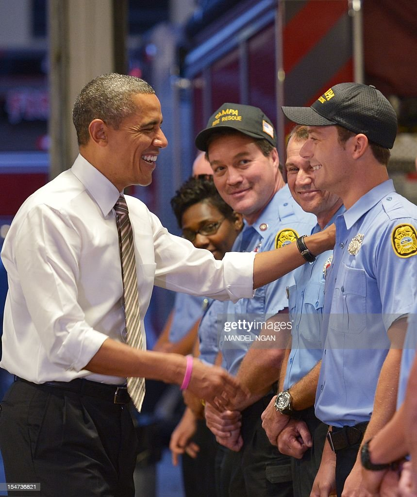 US President Barack Obama chats with firefighters after dropping off doughnuts for them at fire station number 14 on October 25, 2012 in Tampa, Florida. AFP PHOTO/Mandel NGAN