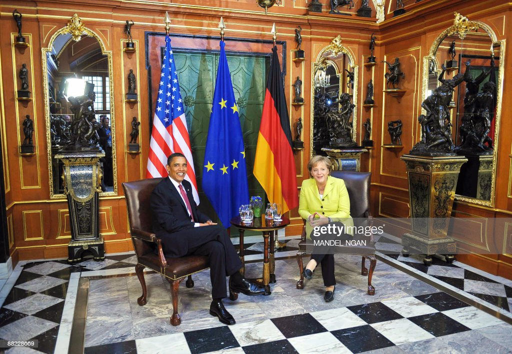 US President <a gi-track='captionPersonalityLinkClicked' href=/galleries/search?phrase=Barack+Obama&family=editorial&specificpeople=203260 ng-click='$event.stopPropagation()'>Barack Obama</a> chats with German Chancellor <a gi-track='captionPersonalityLinkClicked' href=/galleries/search?phrase=Angela+Merkel&family=editorial&specificpeople=202161 ng-click='$event.stopPropagation()'>Angela Merkel</a> during a bilateral meeting in the 'Gruenes Gewoelbe' at Dresden Castle on June 5, 2009 in the center of the eastern German town of Dresden, where Allied bombing in the final months of World War II flattened the city in 1945 and killed an estimated 35,000 people. After policy talks and a news conference in Dresden, Obama and Merkel are due to travel to Buchenwald, the former Nazi concentration camp where more than 56,000 prisoners died in horrendous conditions. AFP PHOTO/Mandel NGAN