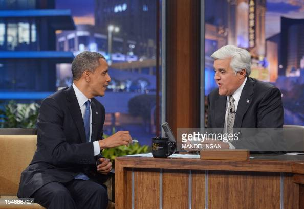 """US President Barack Obama chats with host Jay Leno during a taping of """"The Tonight Show with Jay Leno"""" October 24 2012 at NBC Studios in Burbank..."""