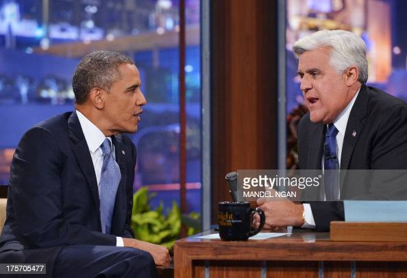 US President Barack Obama chats with host Jay Leno during a taping of The Tonight Show with Jay Leno at NBC Studios on August 6 2013 in Burbank...
