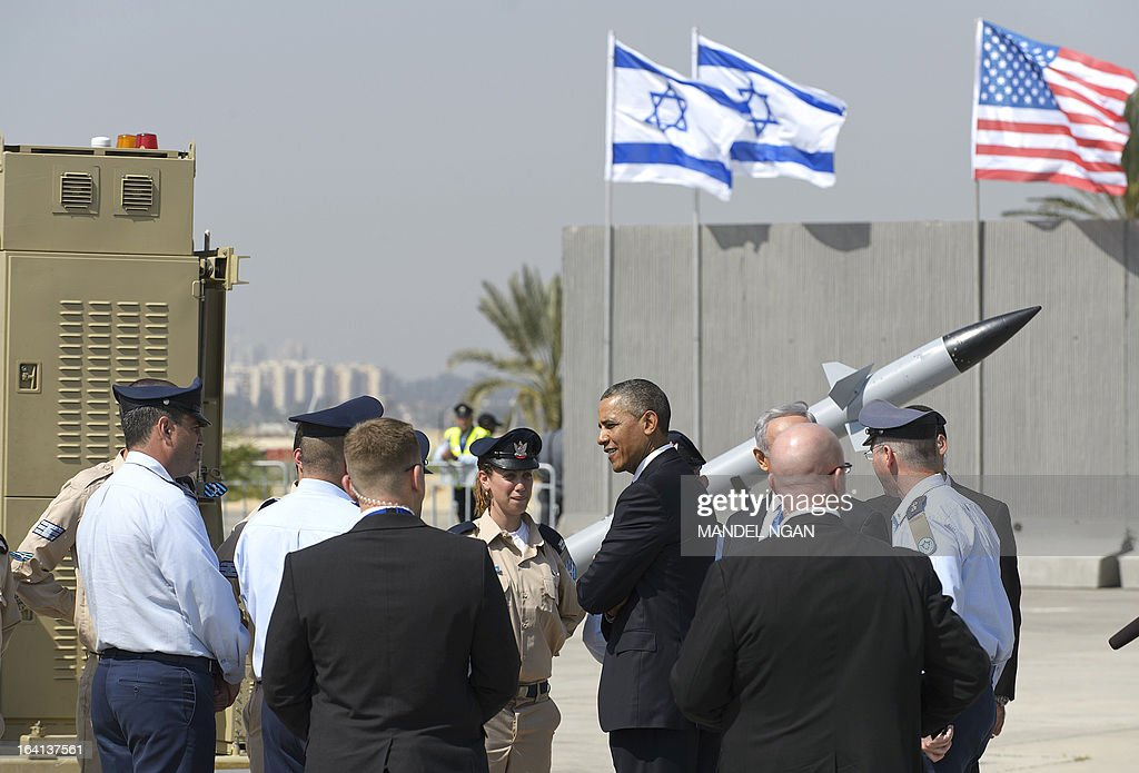 US President Barack Obama chats with military personnel while viewing an Iron Dome missile battery on March 20, 2013, at Ben Gurion International Airport on the outskirts of Tel Aviv. Obama landed in Israel for the first time as US president, on a mission to ease past tensions with his hosts and hoping to paper over differences on handling Iran's nuclear threat. AFP PHOTO/Mandel NGAN