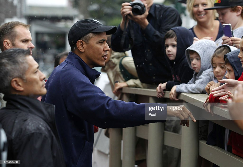 U.S. President <a gi-track='captionPersonalityLinkClicked' href=/galleries/search?phrase=Barack+Obama&family=editorial&specificpeople=203260 ng-click='$event.stopPropagation()'>Barack Obama</a> chats with onlookers in front of Nancy's Restaurant before placing a take-out order August 13, 2013 in Oak Bluffs, Massachusetts. President Obama and his family are spending the week on the island for their summer vacation.
