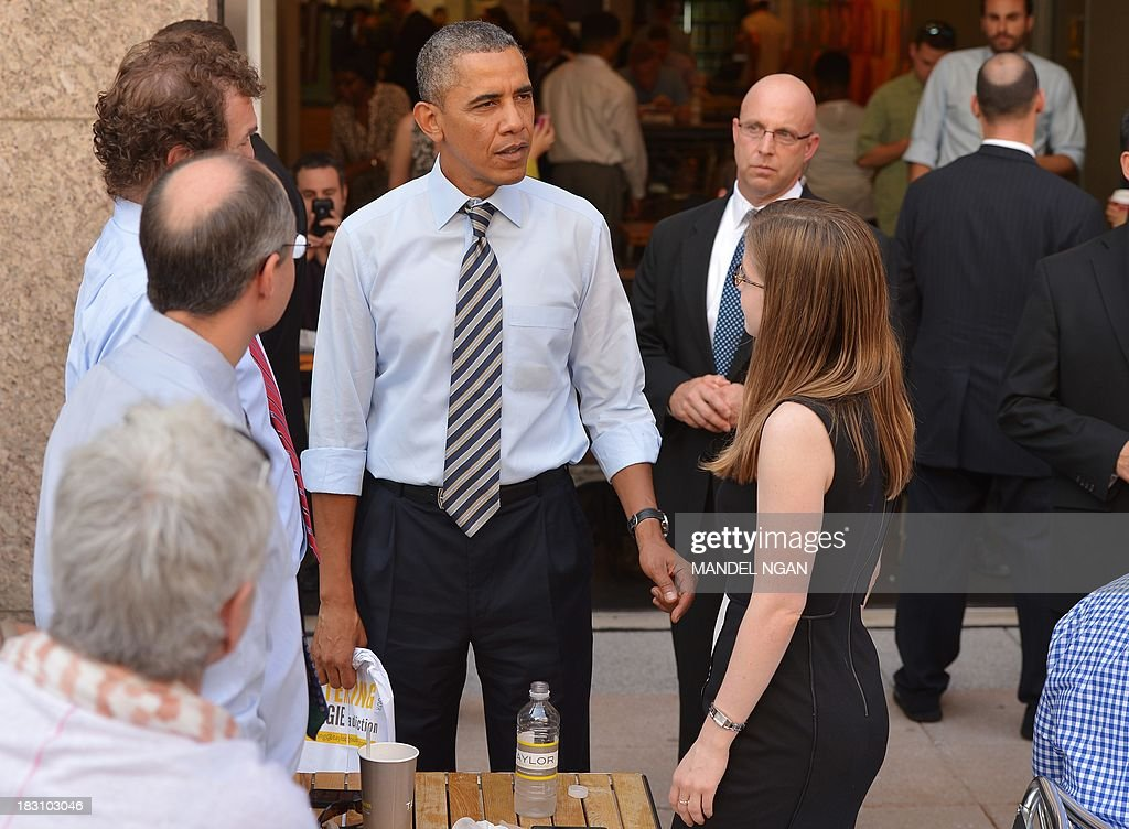 US President Barack Obama chats with patrons outside of Taylor Gourmet Deli on Pennsylvania Ave in Washington, DC on October 4, 2013. Obama walked over to the deli with US Vice President Joe Biden and ordered sandwiches to go. Mandel NGAN