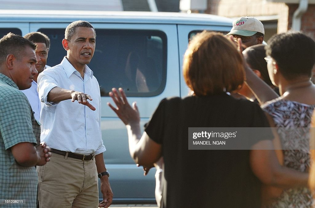 US President Barack Obama chats with residents while touring damage caused by Hurricane Isaac in the Ridgewood neighbourhood of LaPlace, in Saint John the Baptist Parish, Louisiana, September 3, 2012. AFP PHOTO/Mandel NGAN