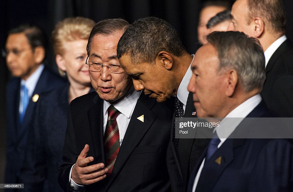U.S. President Barack Obama (C) chats with U.N. Secretary General Ban Ki-moon (L) and Kazakhstan President Nursultan Nazarbayev following the group photo at the 2014 Nuclear Security Summit on March 25, 2014 in The Hague, Netherlands. Leaders from around the world have come to discuss matters related to international nuclear security, though the summit is overshadowed by recent events in Ukraine.