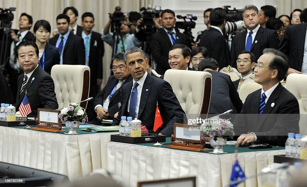 US President Barack Obama (C), Chinese Premier Wen Jiabao (R) and Japanese Prime Minister Yoshihiko Noda (L) attend an East Asian Summit Plenary Session at the Peace Palace in Phnom Penh on November 20, 2012. During the two-day East Asia Summit, Obama was scheduled to hold talks with the leaders of the 10-member Association of Southeast Asian Nations (ASEAN) along with Chinese Premier Wen Jiabao and Japan's Premier Yoshihiko Noda. AFP PHOTO Jewel Samad
