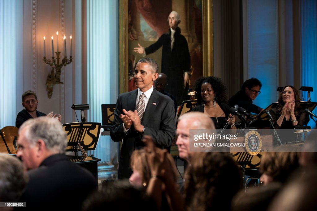 US President Barack Obama claps during the Gershwin Prize Concert in the East Room of the White House May 22, 2013 in Washington, DC. The Obamas hosted the performance to honor singer and song writer Carole King's Gershwin Prize. AFP PHOTO/Brendan SMIALOWSKI
