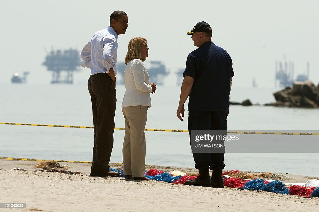 US President Barack Obama (L), Coast Guard Commandant charged with overseeing the oil spill response Admiral Thad Allen (R) and LaFourche Parish President Charlotte Randolph (C) speak near boom as they tour Port Fourchon Beach, Louisiana, on May 28, 2010 before a briefing on the federal government's response to the Gulf Coast oil spill. Obama arrived in Louisiana to view the oil spill response amid suspense over the latest bid to cap the massive leak in the Gulf of Mexico. AFP PHOTO/Jim WATSON