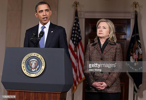 S President Barack Obama condemns the ongoing violence in Libya while delivering a statement as Secretary of State Hillary Clinton listens in the...