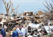 US President Barack Obama confers with FEMA Director Craig Fugate Oklahoma Governor Mary Fallin and Rep Tom Cole as he tours a tornado affected area...