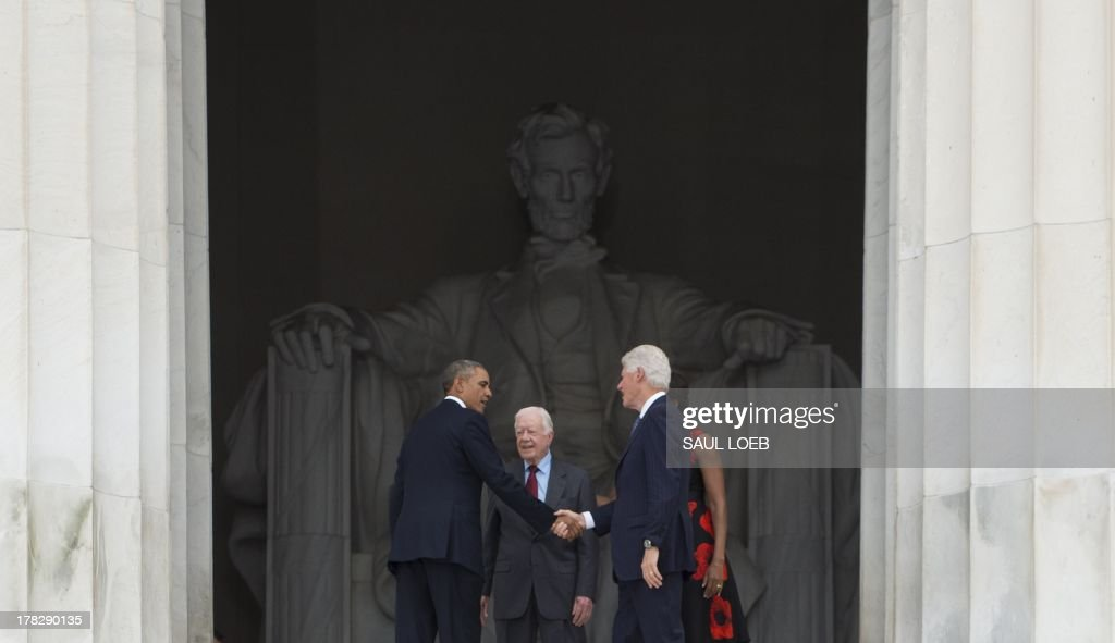 US President Barack Obama (L) confers with former US presidents Bill Clinton (R) and Jimmy Carter (C) after attending the Let Freedom Ring Commemoration and Call to Action marking the 50th anniversary of the March on Washington for Jobs and Freedom at the Lincoln Memorial in Washington, DC on August 28, 2013. Thousands gathered on the mall on the anniversary of the march and Dr. Martin Luther King, Jr.'s famous 'I Have a Dream' speech. AFP PHOTO / Saul LOEB