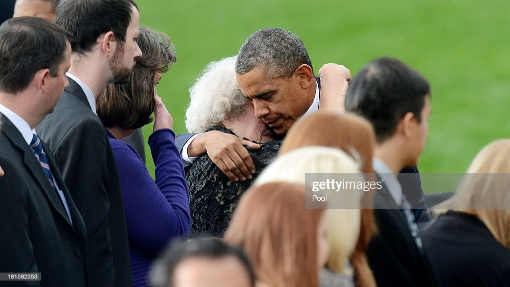 U.S. President Barack Obama conforts families of the victims at a memorial for the victims of the Washington Navy Yard shooting September 22, 2013 at the Marine Barracks in Washington, D.C. President Obama and the first lady visited with families of the victims.