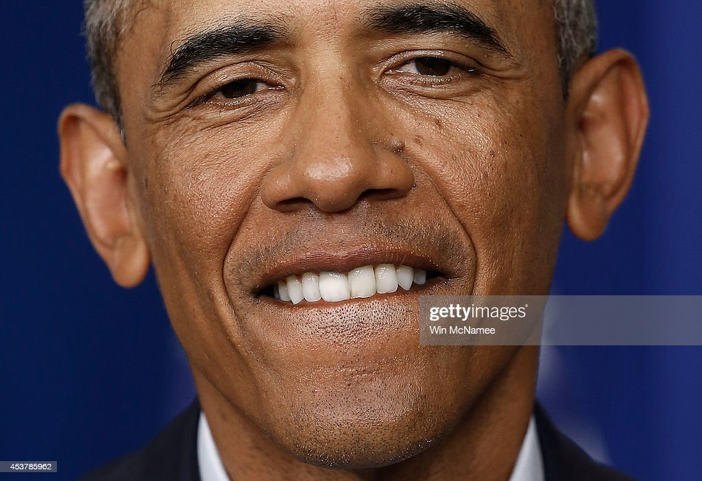 U.S. President <a gi-track='captionPersonalityLinkClicked' href=/galleries/search?phrase=Barack+Obama&family=editorial&specificpeople=203260 ng-click='$event.stopPropagation()'>Barack Obama</a> congratulates ABC correspondent Ann Compton on her retirement after delivering a statement and fielding questions in the Brady Press Briefing Room of the White House on August 18, 2014 in Washington, DC. Obama returned early from his vacation in Martha's Vineyard to hold meetings with his national security team and also with U.S. Attorney General Eric Holder in regards to the situation in Iraq and the continuing violence in Ferguson, Missouri.