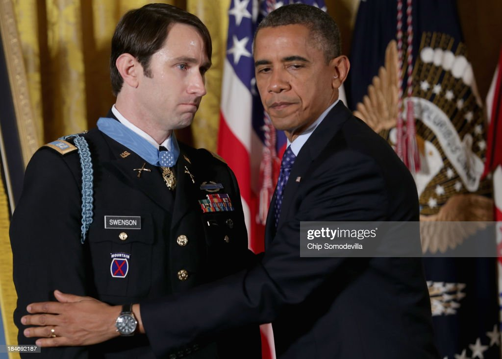 U.S. President Barack Obama congratulates former U.S. Army Captain William Swenson after awarding him the Medal of Honor during a ceremony in the East Room of the White House October 15, 2013 in Washington, DC. Honored for his actions in the 2009 Battle of Ganjgal Valley in the Kunar Province of Afghanistan, Swenson is the sixth living veteran of the Iraq and Afghanistan wars to receive the Medal of Honor, awarded to a person who 'distinguished himself conspicuously by gallantry and intrepidity at the risk of his life above and beyond the call of duty.'