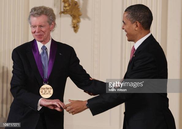 S President Barack Obama congratulates musician Van Cliburn after presenting him with the 2010 National Medal of Arts during a ceremony in the East...