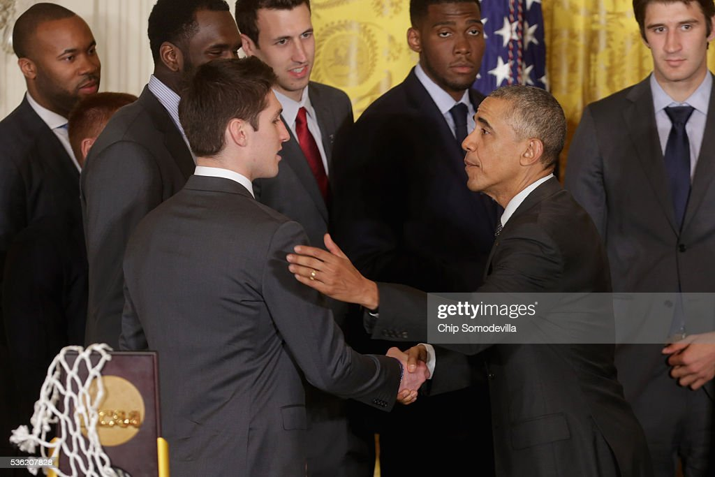 U.S. President Barack Obama (R) congratulates NCAA 2016 National Champions Villanova University's men's basketball player Ryan Arcidiacono (L) and his teammates in the East Room of the White House May 31, 2016 in Washington, DC. Obama said that although he did not pick the Wildcats to win the championship that the final game against the University of North Carolina was one of the greatest of college basketball history.